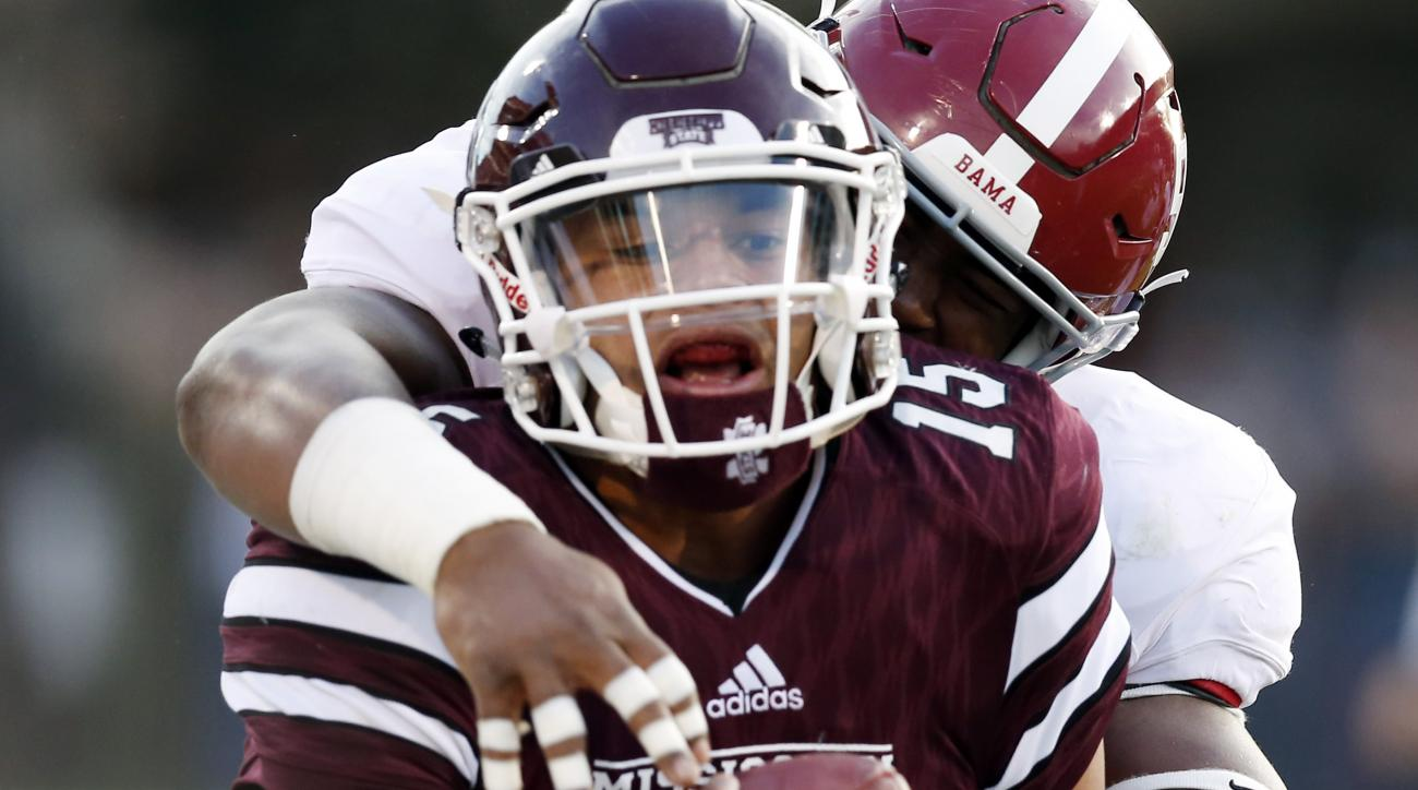 Mississippi State quarterback Dak Prescott (15) is tackled by Alabama linebacker Tim Williams (56) following a long run during the first half of an NCAA college football game in Starkville, Miss., Saturday, Nov. 14, 2015. (AP Photo/Rogelio V. Solis)