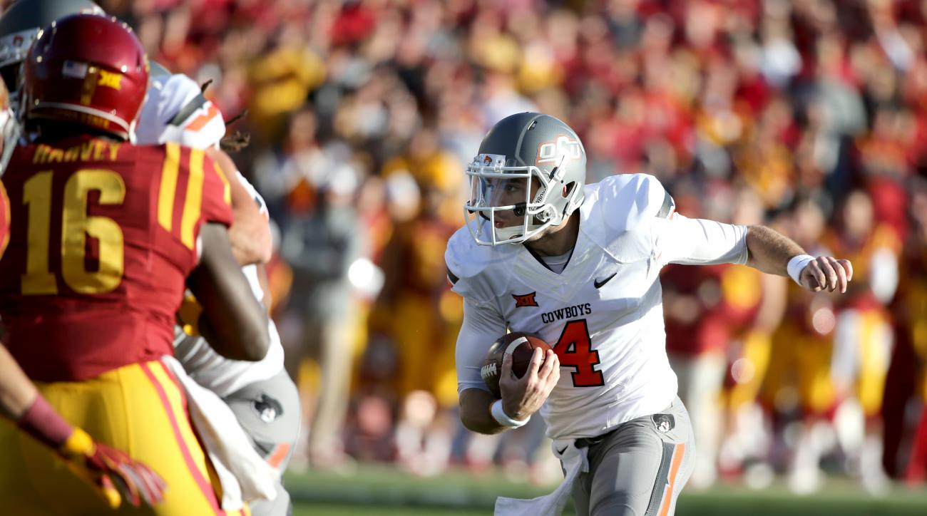 Oklahoma State quarterback J.W. Walsh runs the ball during the first half of an NCAA college football game against Iowa State, Saturday, Nov. 14, 2015, in Ames, Iowa. (AP Photo/Justin Hayworth)