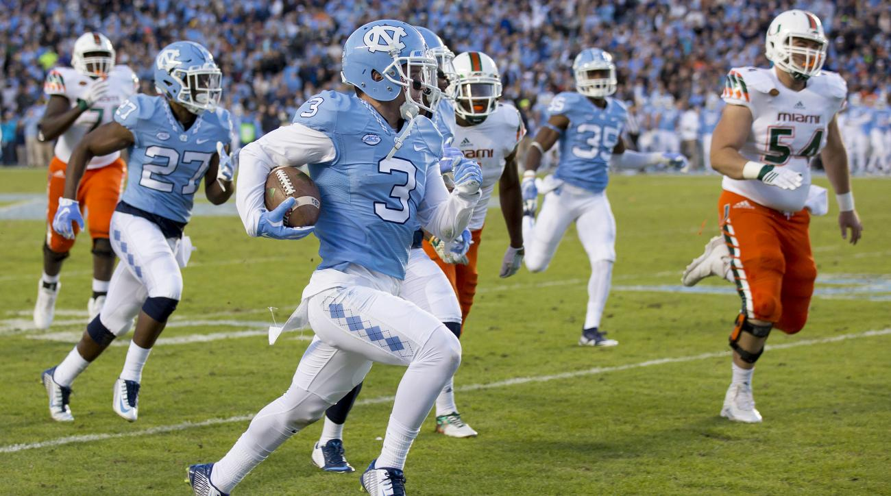 North Carolina's Ryan Switzer returns a punt for a touchdown against Miami during the first half of an NCAA college football game, in Chapel Hill, N.C., Saturday, Nov. 14, 2015. (AP Photo/Rob Brown)