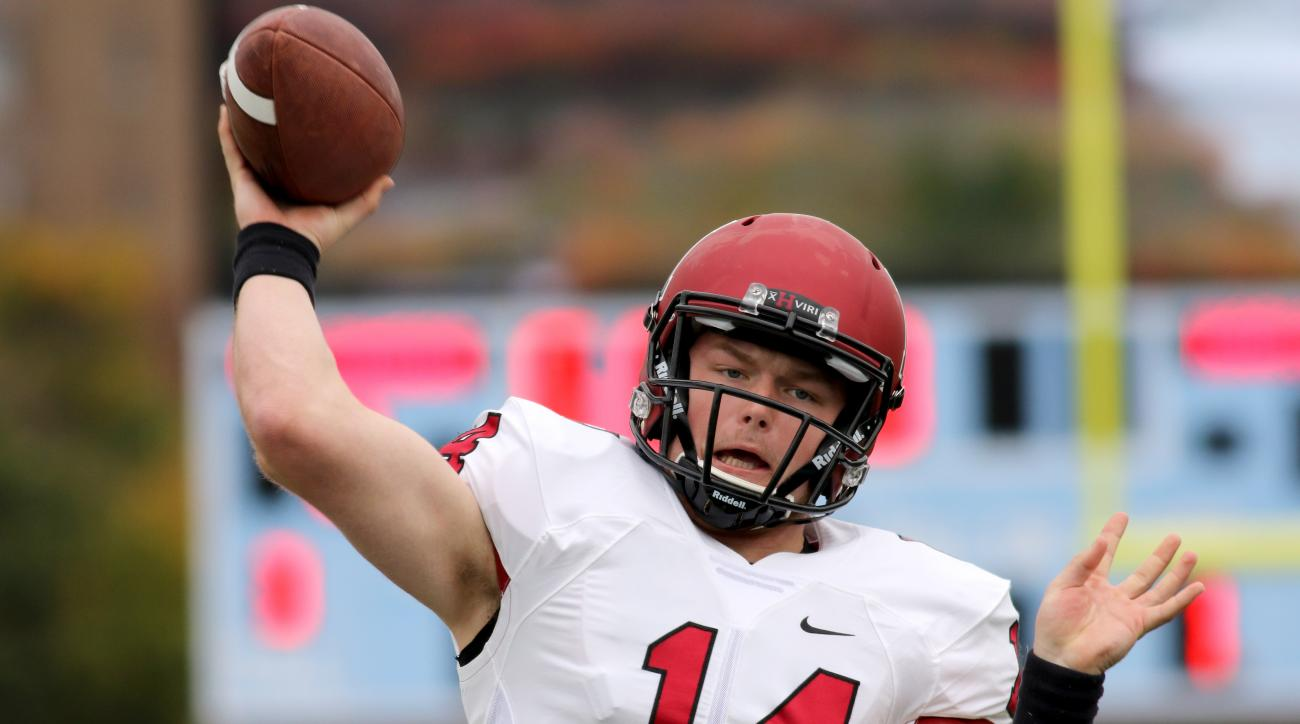 Harvard Crimson's QB Tom Stewart #14 warms up against the Columbia Lions before a college football game on Saturday, November 7, 2015 in Manhattan, NY.  Harvard won 24-16. (AP Photo/Gregory Payan)