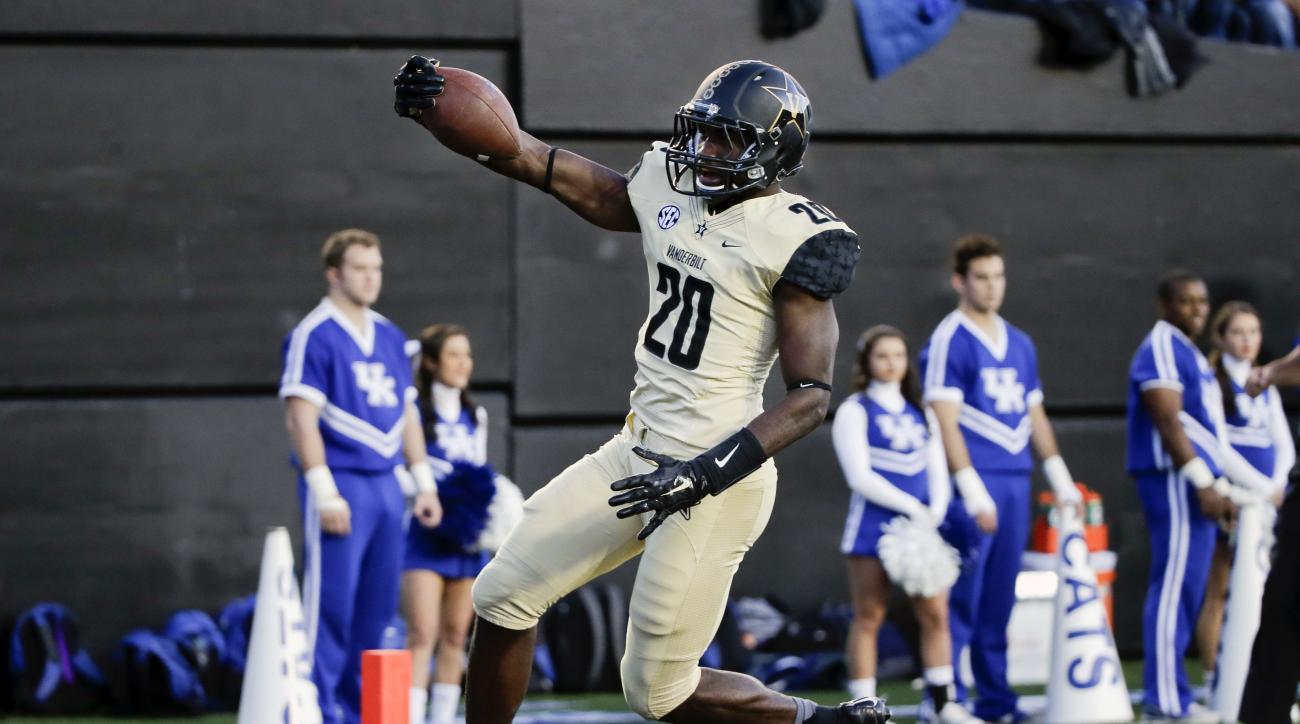 Vanderbilt safety Oren Burks (20) returns a pass interception 30 yards for a touchdown against Kentucky in the first half of an NCAA college football game Saturday, Nov. 14, 2015, in Nashville, Tenn. (AP Photo/Mark Humphrey)