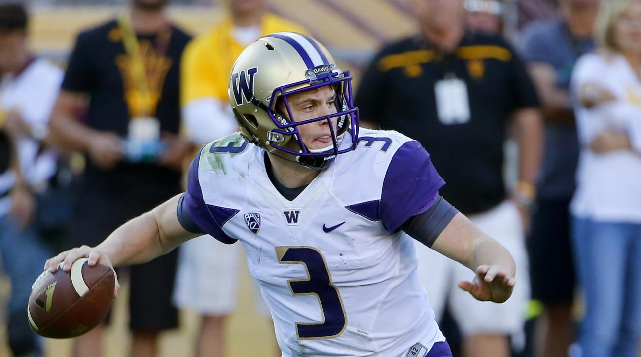 Washington's Jake Browning looks to throw against Arizona State during the second half of an NCAA college football game Saturday, Nov. 14, 2015, in Tempe, Ariz. Arizona State defeated Washington 27-17. (AP Photo/Ross D. Franklin)