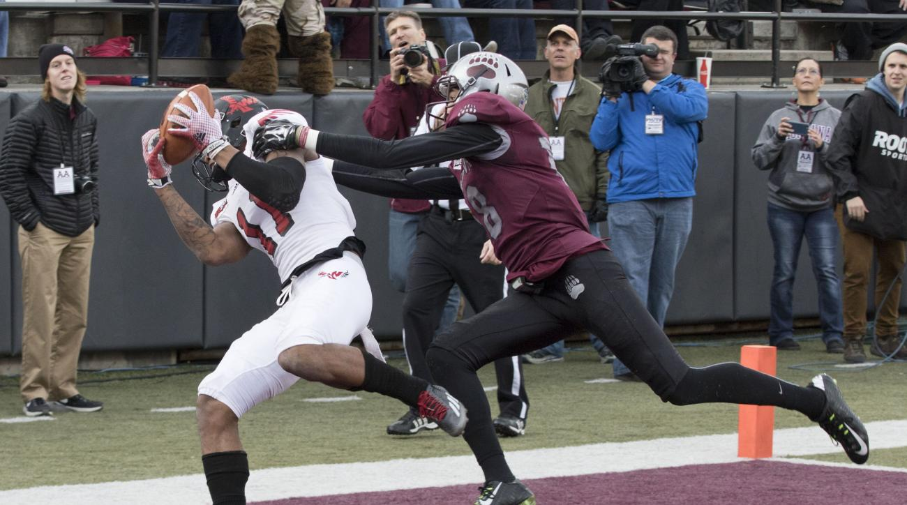 Eastern Washington wide receiver Kendrick Bourne (11) catches a touchdown pass over Montana cornerback JR Nelson (18) in the first half of an NCAA college football game Saturday, Nov. 14, 2015, in Missoula, Mont. (AP Photo/Patrick Record)