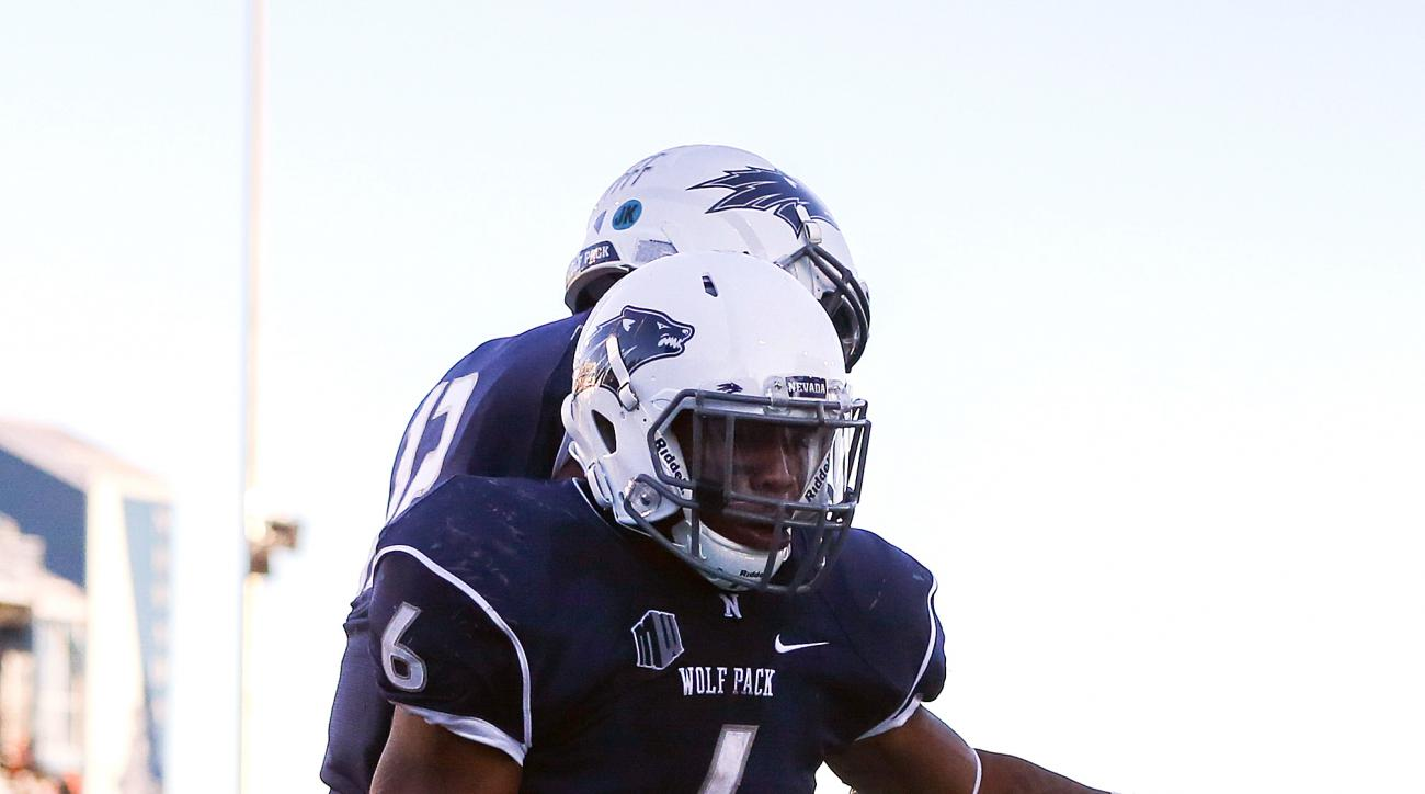 Nevada running back Don Jackson (6) celebrates his touchdown against San Jose State with teammate Hasaan Henderson (12) during the second half of an NCAA college football game in Reno, Nev., on Saturday, Nov. 14, 2015. The touchdown forced the game into o