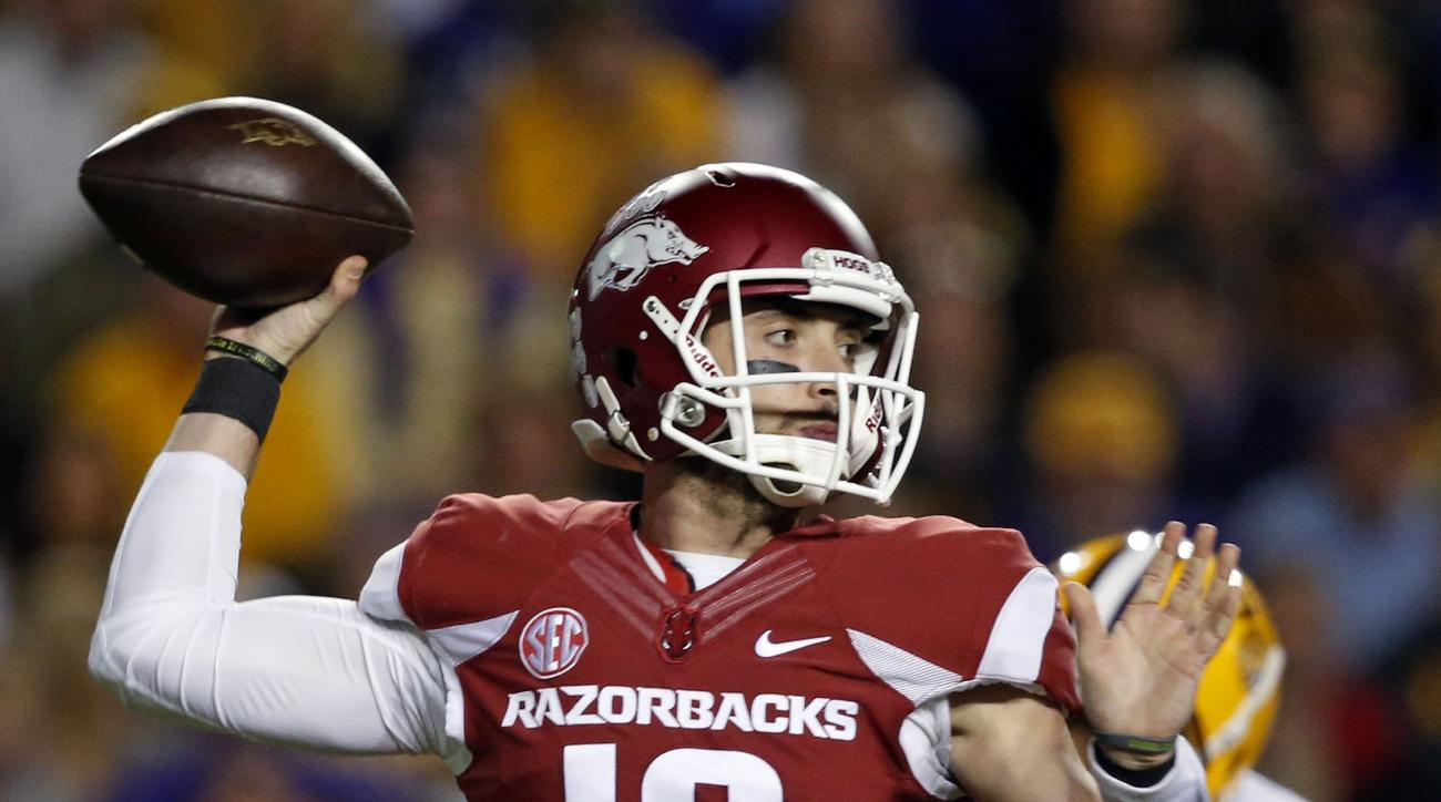 Arkansas quarterback Brandon Allen (10) passes in the first half of an NCAA college football game against LSU in Baton Rouge, La., Saturday, Nov. 14, 2015. (AP Photo/Gerald Herbert)