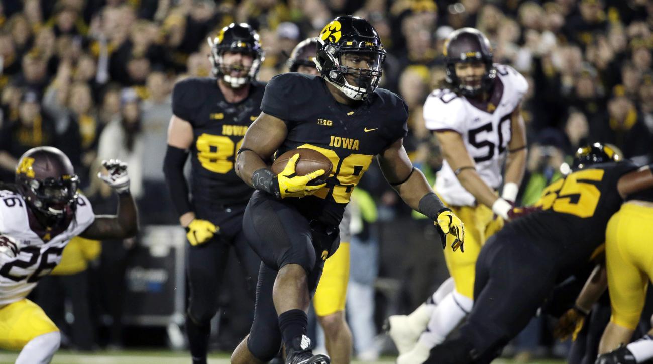 Iowa running back LeShun Daniels, Jr. (29) scores a touchdown during the first half of an NCAA college football game against Minnesota, Saturday, Nov.14, 2015, in Iowa City, Iowa.  (AP Photo/Nam Y. Huh)