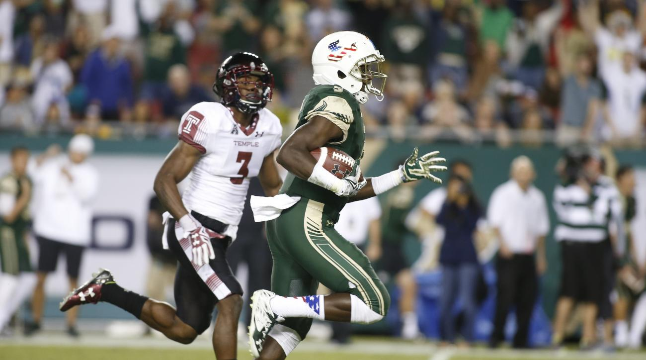 South Florida running back Marlon Mack gets away from Temple defensive back Sean Chandler (3) on a 57-yard touchdown run during the second quarter of an NCAA college football game Saturday, Nov. 14, 2015, in Tampa, Fla. (AP Photo/Brian Blanco)