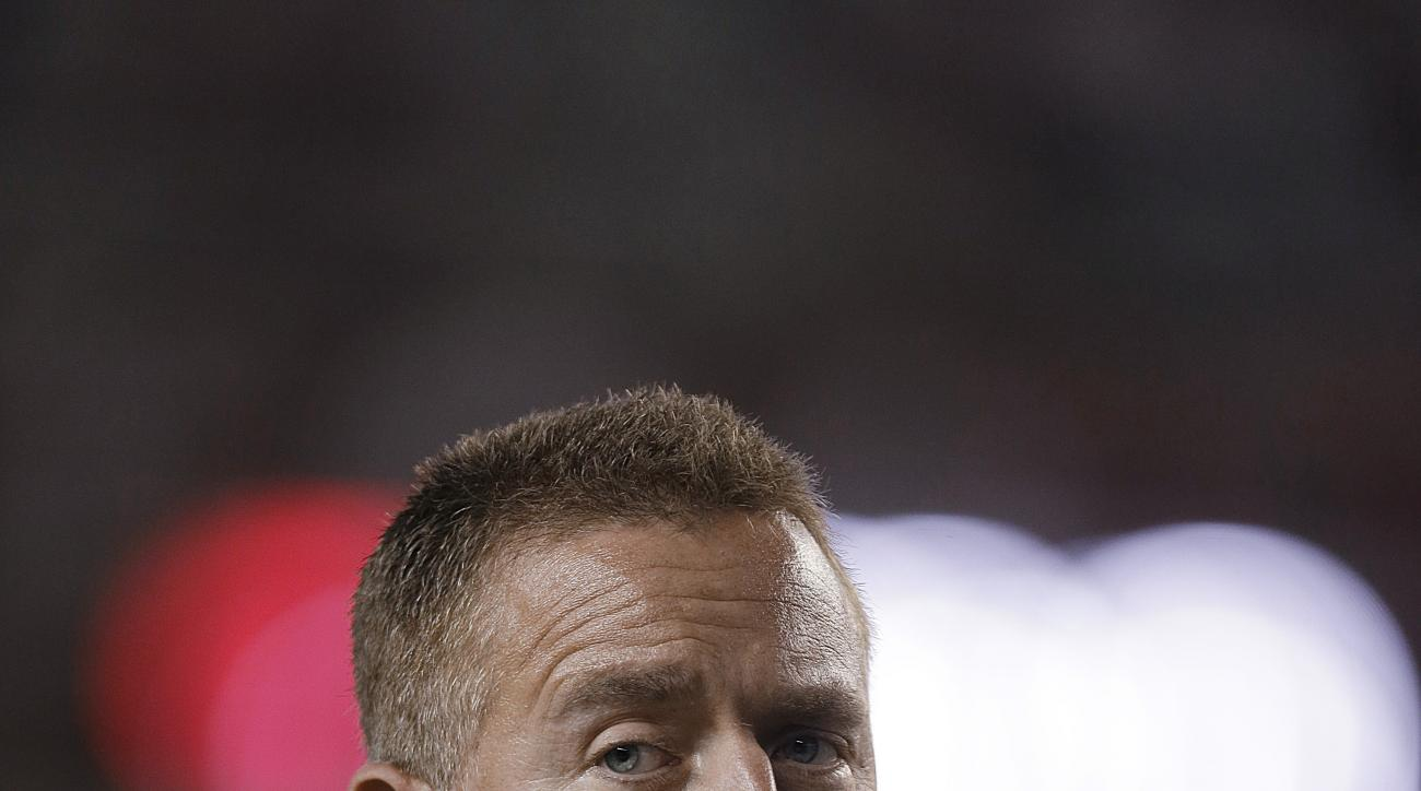 ESPN 's Kirk Herbstreit waits for an NCAA football game, Saturday, Sept. 19, 2015, in Tuscaloosa, Ala., between Alabama and Mississippi. (AP Photo/Butch Dill)