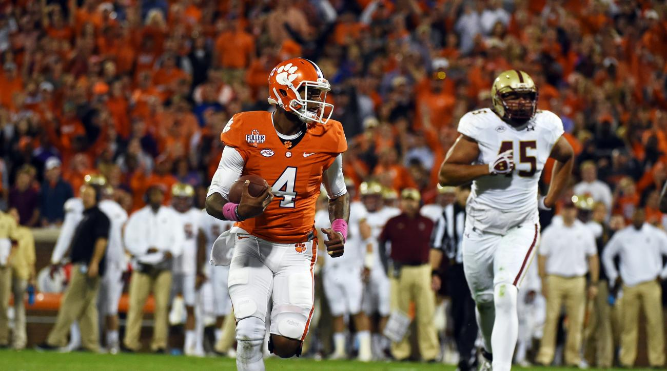 FILE - In this Oct. 17, 2015, file photo, Clemson quarterback Deshaun Watson (4) runs for a touchdown as Boston College defensive lineman Mehdi Abdesmad (45) trails during the first half of an NCAA college football game in Clemson, S.C. In the year of the