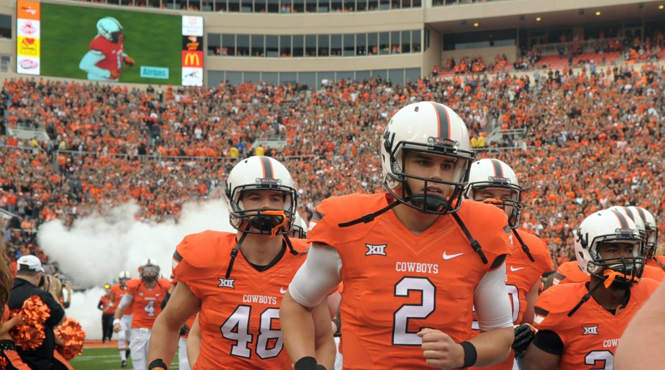 FILE - In this Oct. 24, 2015, file photo, Oklahoma State quarterback Mason Rudolph (2) jogs onto the field before an NCAA college football game against Kansas in Stillwater, Okla. Rudolph is just a sophomore, but he's in the midst of one of the best seaso