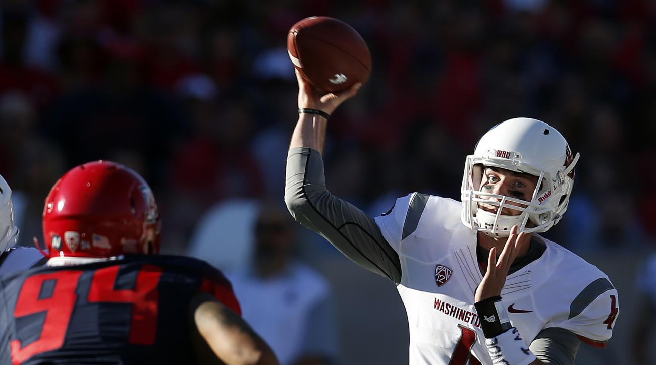 FILE - In this Oct. 24, 2015, file photo, Washington State quarterback Luke Falk (4) throws down field against Arizona during the second half of an NCAA college football game in Tucson, Ariz. Featuring the nation's top passing attack, along with an improv