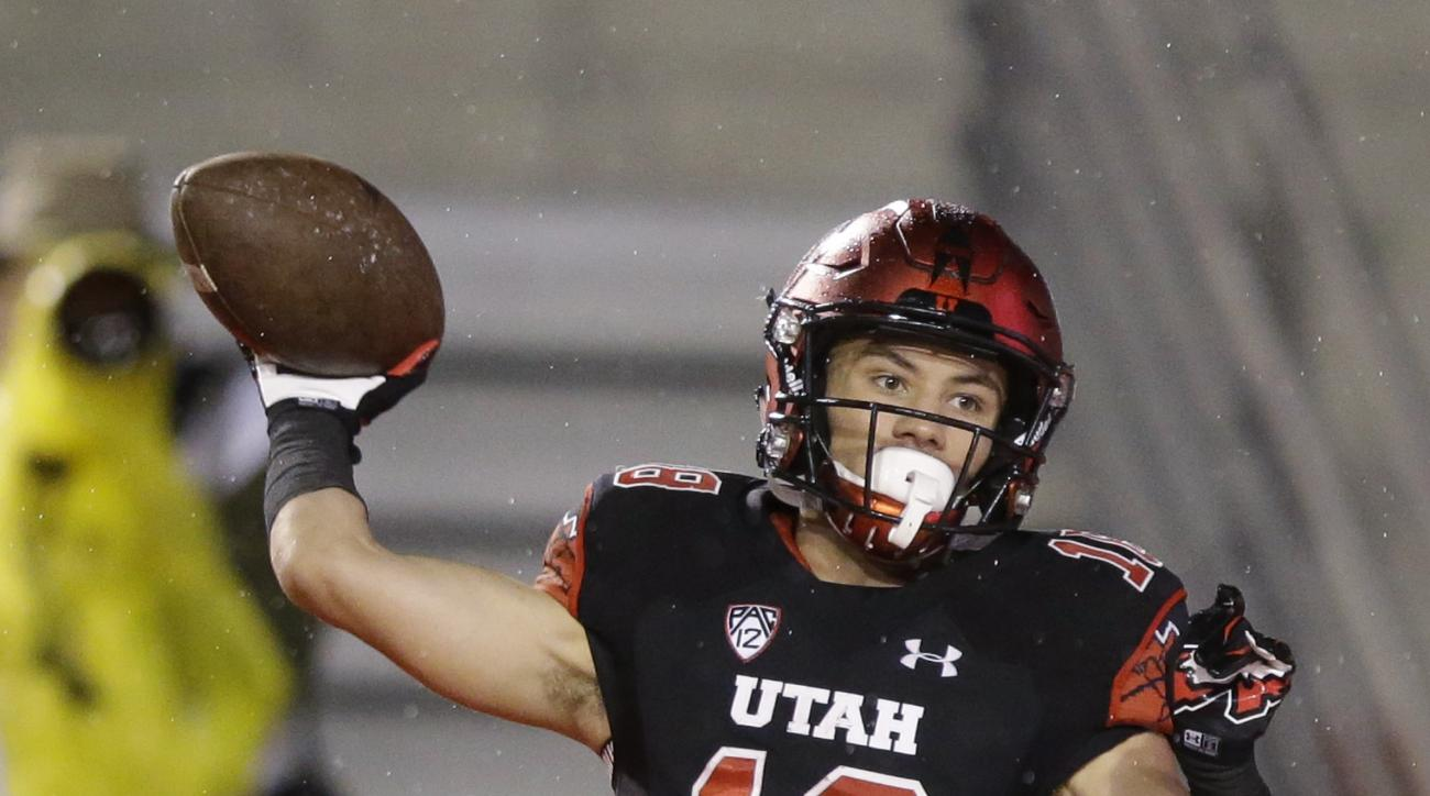 In this Oct. 17, 2015, photo, Brittain Covey throws a pass in the second half during an NCAA college football game against Arizona State, in Salt Lake City. Opponents laugh when they see 5-foot-8, 166-pound Covey before games against No. 18 Utah, but the