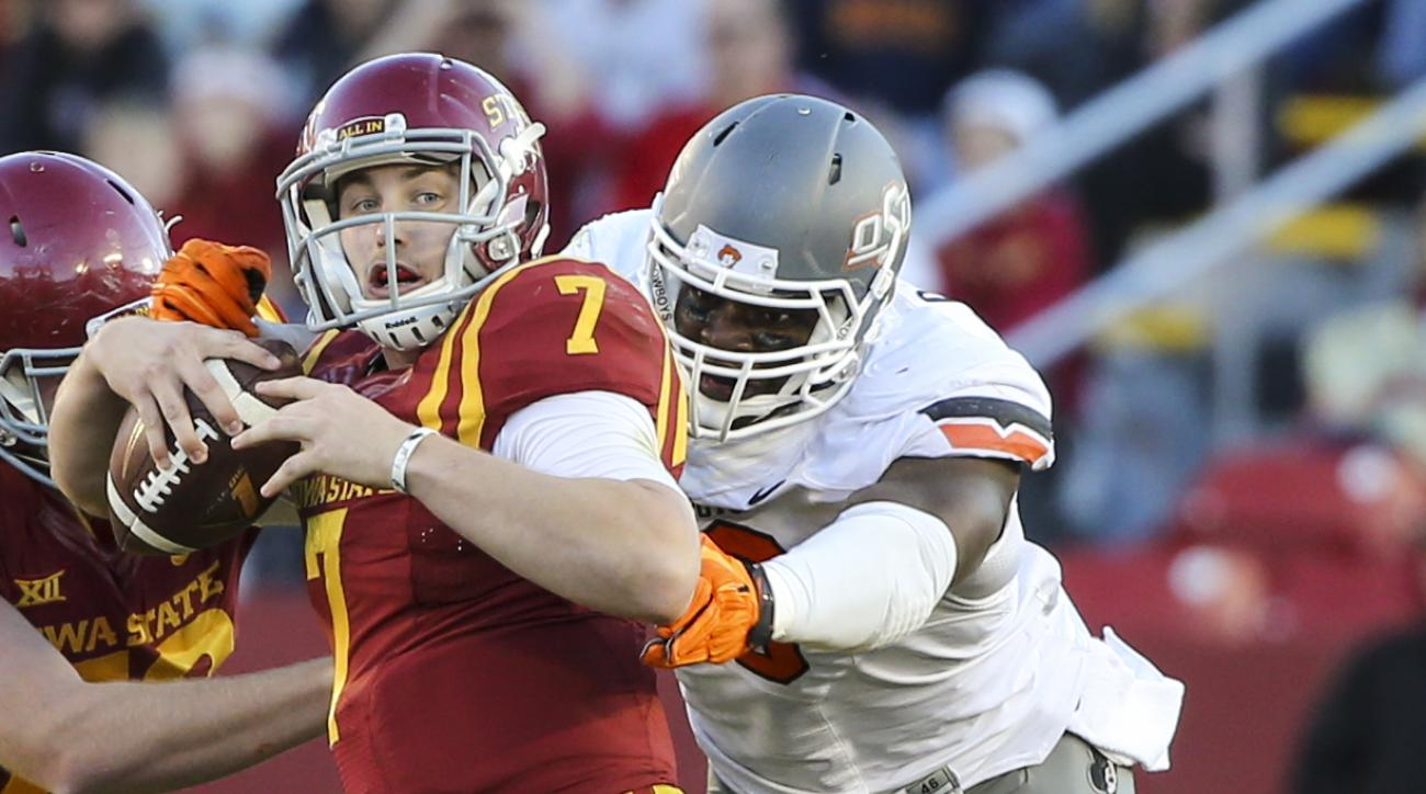 FILE - In this Nov. 14, 2015, file photo, Oklahoma State defensive end Emmanuel Ogbah, right, sacks Iowa State quarterback Joel Lanning during the first half of an NCAA college football game,  in Ames, Iowa.  Emmanuel Ogbah, the nation's active career sac