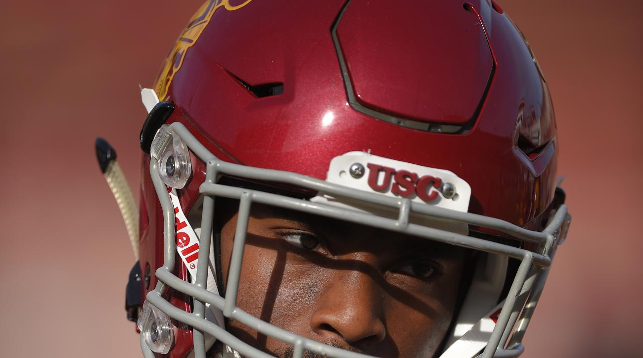 Southern California running back Tre Madden warms up prior to an NCAA college football game against Utah, Saturday, Oct. 24, 2015, in Los Angeles. (AP Photo/Mark J. Terrill)