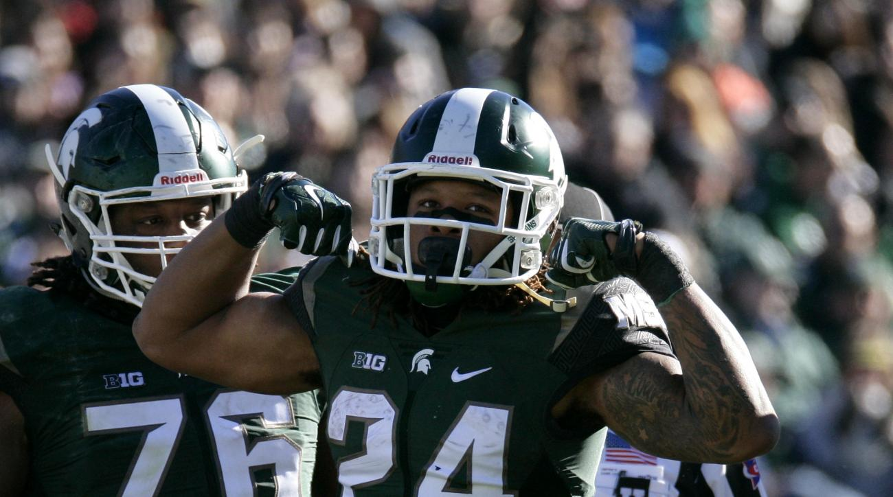 FILE - In this Saturday, Nov. 14, 2015, file photo, Michigan State's Gerald Holmes (24) celebrates during the second quarter of an NCAA college football game against Maryland in East Lansing, Mich. (AP Photo/Al Goldis, File)