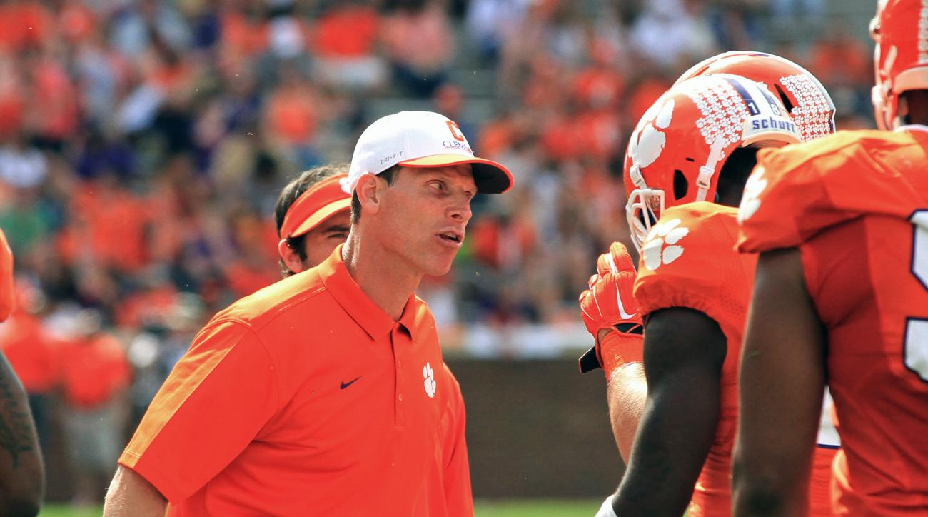 FILE - In this April 11, 2015, file photo, Clemson defensive coordinator Brent Venables, left, gets on a player during Clemson's NCAA college football spring game at Memorial Stadium in Clemson, S.C. Clemson's top-ranked defense came at teams in waves las