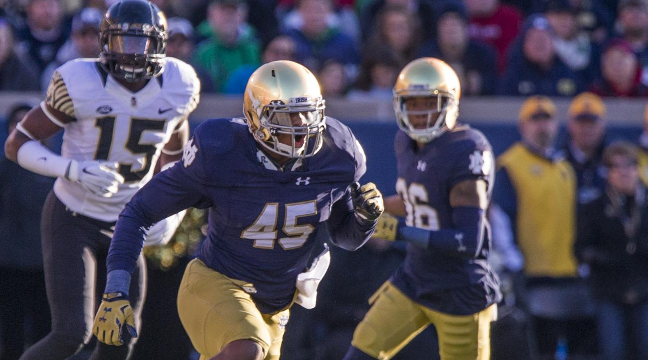 In this Nov. 14, 2015, photo, Notre Dame's Romeo Okwara (45) defends against Wake Forest during an NCAA college football game in South Bend, Ind. Okwara has eight sacks in the past five games, giving him nine for the season as the fifth-ranked Fighting Ir