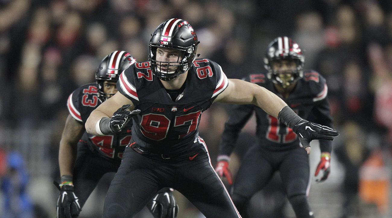 FILE - In this Oct. 17, 2015, file photo, Ohio State defensive lineman Joey Bosa plays against Penn State during an NCAA college football game, in Columbus, Ohio. The junior is expected to enter the 2016 NFL draft and will likely play his last game in Ohi