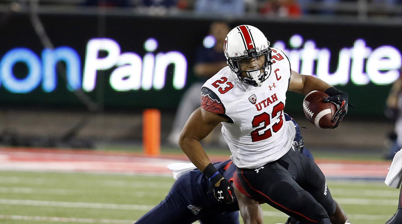 FILE - In this Saturday, Nov. 14, 2015 file photo, Utah running back Devontae Booker carries the ball during the first half of an NCAA college football game against Arizona in Tucson, Ariz.  Utah running back Devontae Booker will miss the final two games