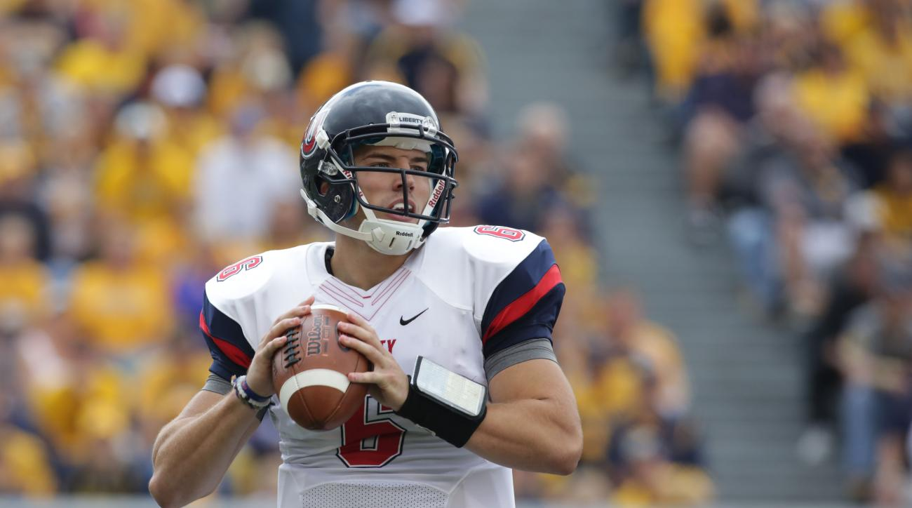 Liberty quarterback Josh Woodrum (6) during the first half/ second half of a NCAA college football game, Saturday, Sept. 12, 2015, in Morgantown, W.Va. (AP Photo/Raymond Thompson)