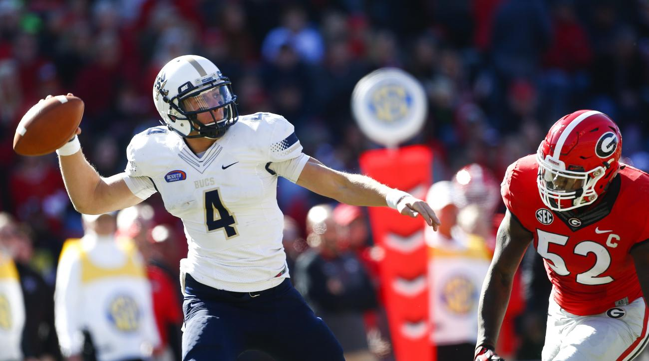 Charleston Southern quarterback Austin Brown (4) throws under pressure from Georgia linebacker Amarlo Herrera (52) in the first half of an NCAA college football game, Saturday, Nov. 22, 2014, in Athens, Ga. (AP Photo/John Bazemore)
