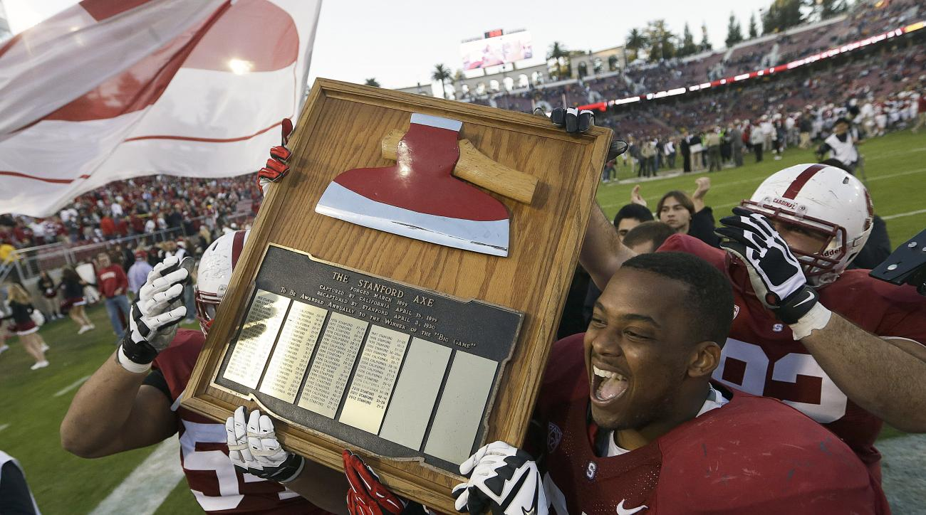 FILE - In this Nov. 23, 2013, file photo, Stanford players celebrate with The Stanford Axe after a win over California in an NCAA college football game in Stanford, Calif. In five years at California, safety Stefan McClure has not laid his hands on the co