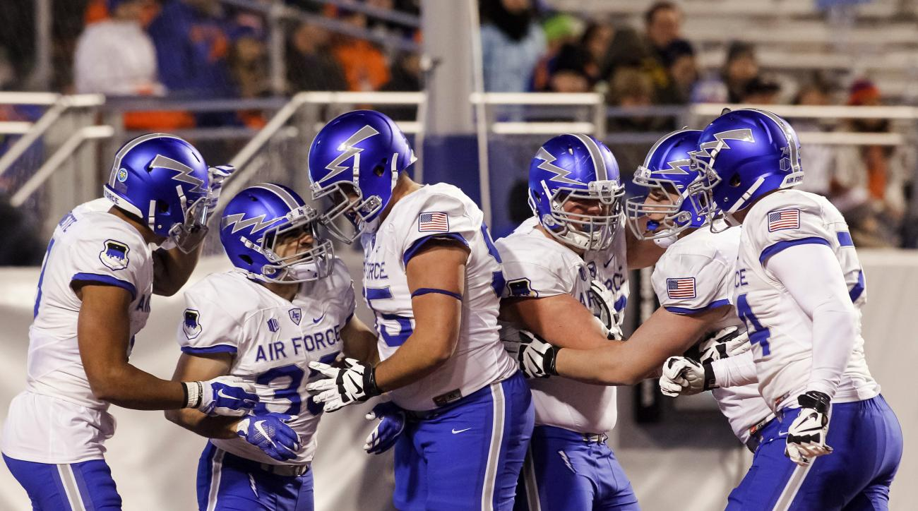 Air Force celebrates a touchdown by running back Timothy McVey, second from left, during the first half of an NCAA college football game against Boise State in Boise, Idaho, on Friday, Nov. 20, 2015. (AP Photo/Otto Kitsinger)