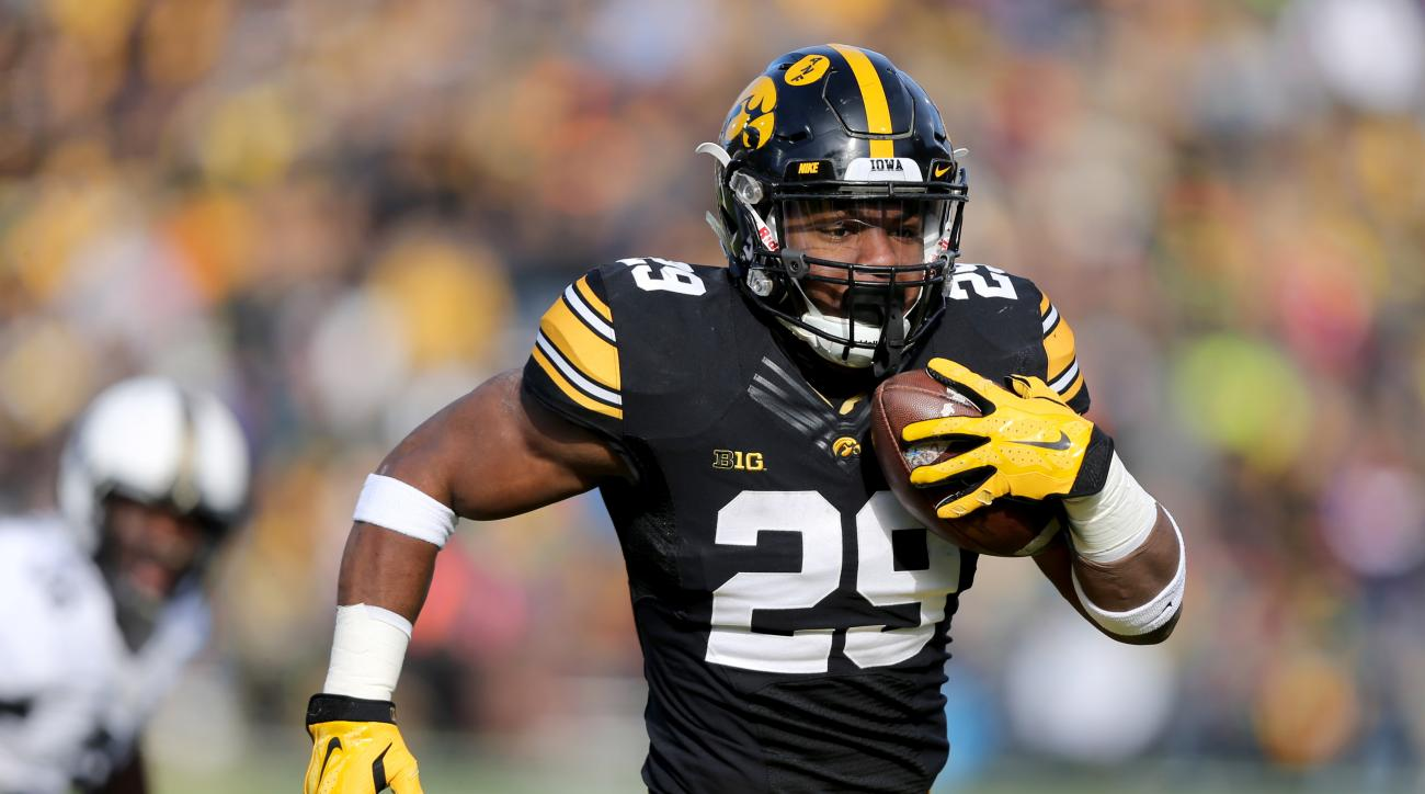 Iowa running back LeShun Daniels Jr. runs for a touchdown during the first half of an NCAA college football game against Purdue, Saturday, Nov. 21, 2015, in Iowa City, Iowa. (AP Photo/Justin Hayworth)