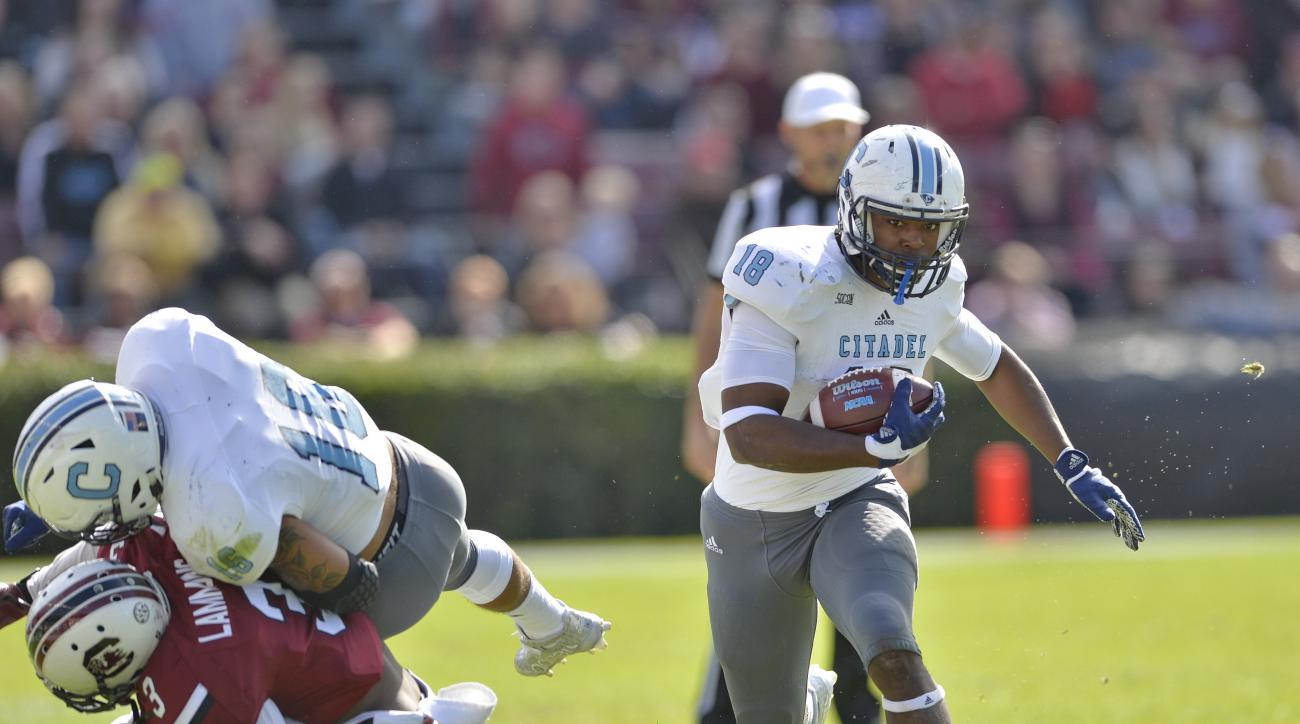 Citadel's Cam Jackson breaks out of the backfield with blocking help from Vinny Miller, who hits South Carolina's Chris Lammons, during the first half of an NCAA college football game Saturday, Nov. 21, 2015,  in Columbia,  S.C. (AP Photo/Richard Shiro)