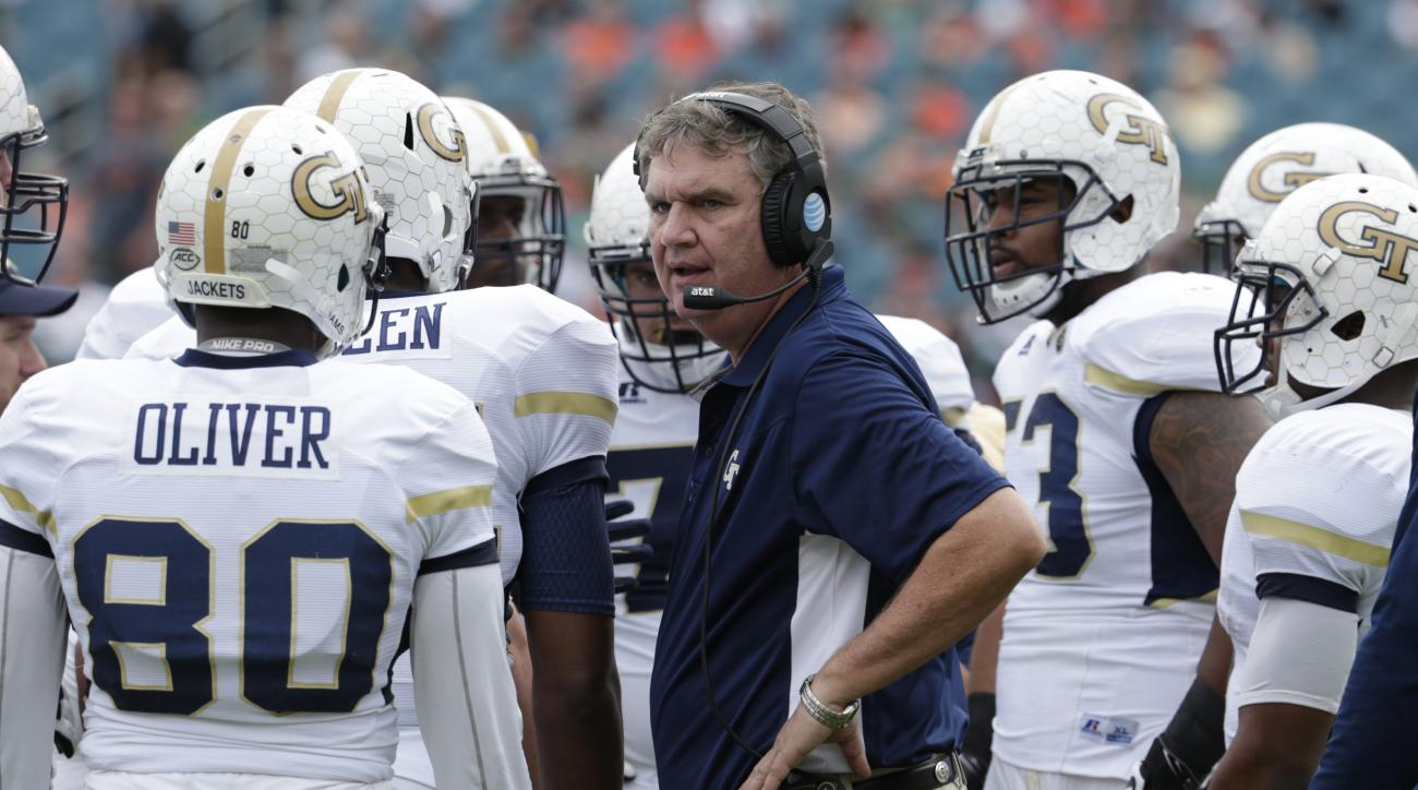 Georgia Tech head coach Paul Johnson talks with his players during the first half of an NCAA college football game against Miami, Saturday, Nov. 21, 2015 in Miami Gardens, Fla. (AP Photo/Lynne Sladky)