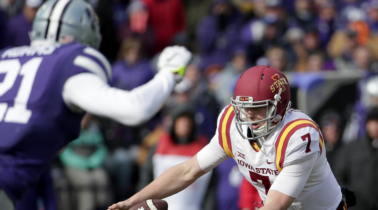 Iowa State quarterback Joel Lanning (7) fumbles the ball before recovering it during the first half of an NCAA college football game against Kansas State, Saturday, Nov. 21, 2015, in Manhattan, Kan. (AP Photo/Charlie Riedel)