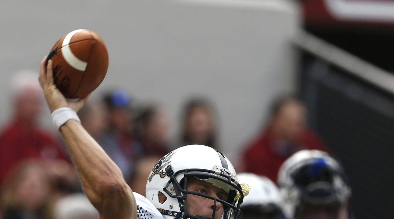 Charleston Southern quarterback Austin Brown (4) warms up before an NCAA football game against Alabama, Saturday, Nov. 21, 2015, in Tuscaloosa, Ala. (AP Photo/Butch Dill)