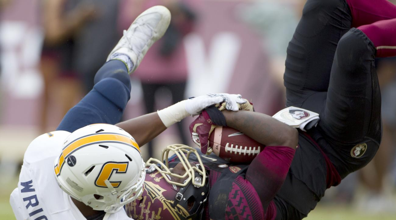 Florida State's Kermit Whitfield comes down with a 33-yard reception at the 1-yard line against Chattanooga's Trevor Wright during the first half of an NCAA college football game in Tallahassee, Fla., Saturday, Nov. 21, 2015.  (AP Photo/Mark Wallheiser)