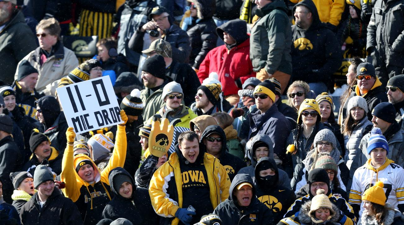 Iowa fans cheer during the first half of an NCAA college football game against Purdue, Saturday, Nov. 21, 2015, in Iowa City, Iowa. Iowa won the game 40-20 to improve to 11-0 on the season. (AP Photo/Justin Hayworth)