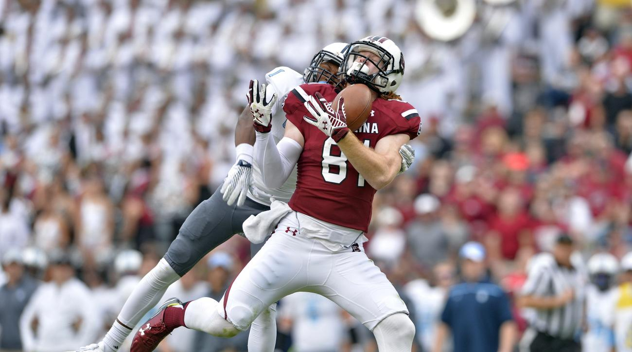 South Carolina's Hayden Hurst can't hang on to the ball while defended by the Citadel's Shy Phillips during the second half of an NCAA college football game Saturday, Nov. 21, 2015, in Columbia,  S.C. Citadel won 23-22. (AP Photo/Richard Shiro)