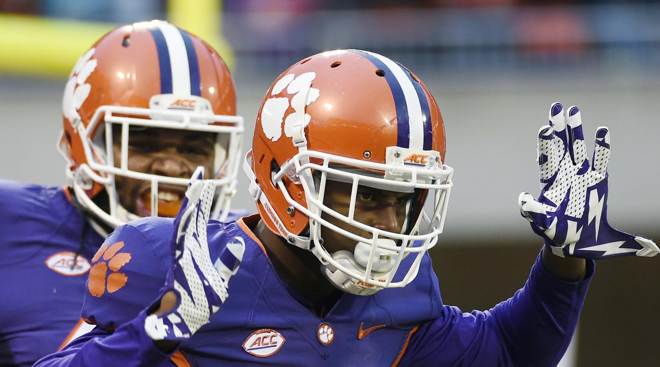 Clemson wide receiver Germone Hopper (5) celebrates after scoring a touchdown as teammate Christian Wilkins looks on during the first half of an NCAA college football game against Wake Forest on Saturday, Nov. 21, 2015, in Clemson, S.C. (AP Photo/Rainier