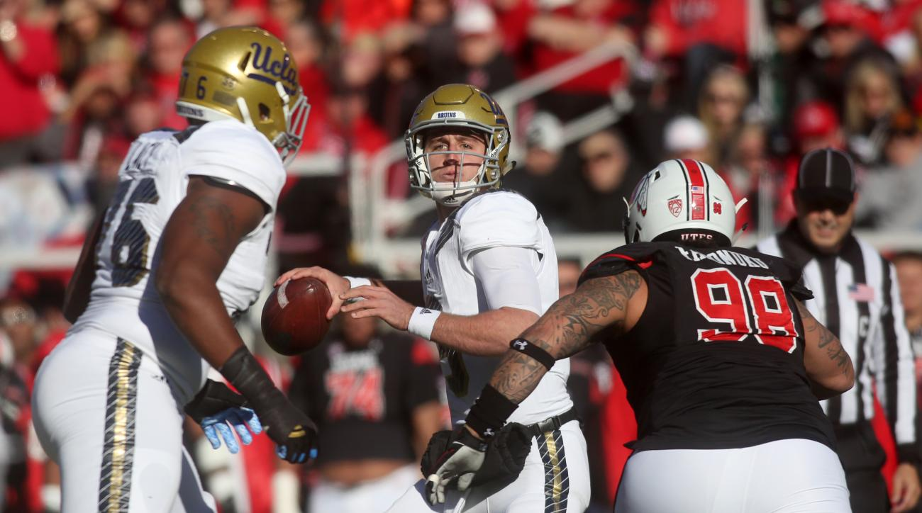 UCLA quarterback Josh Rosen, middle, drops back for a pass as Utah defensive tackle Viliseni Fauonuku (98) goes in for a tackle in the first half of an NCAA college football game on Saturday, Nov. 21, 2015 in Salt Lake City. (AP Photo/Kim Raff)
