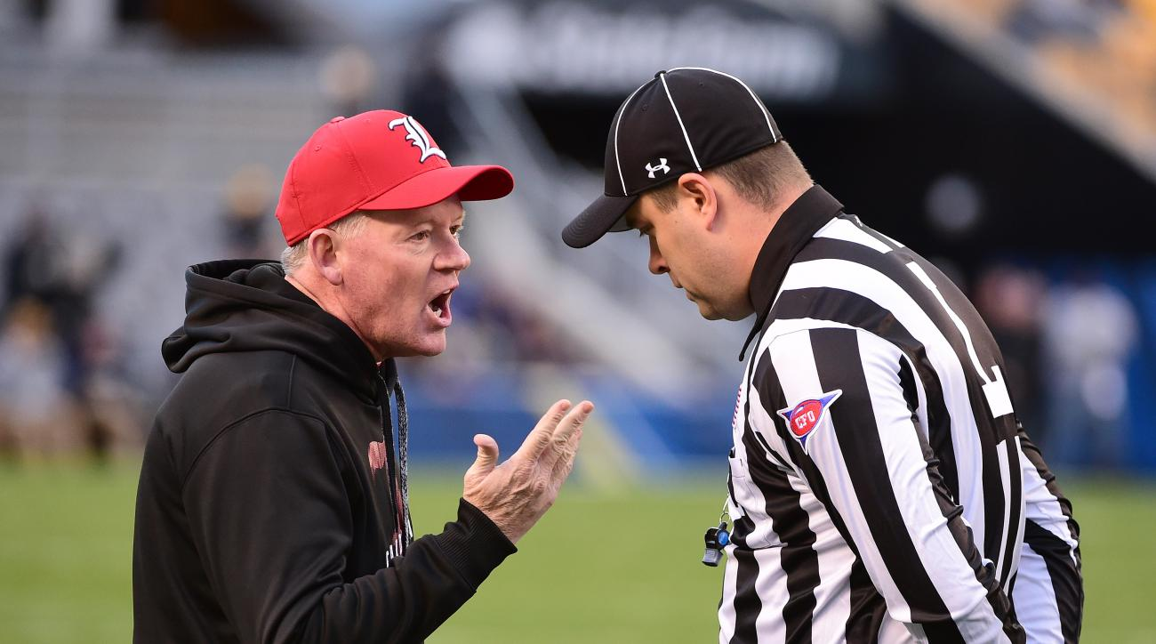 Louisville coach Bobby Petrino talks to an official during the first half of an NCAA college football game against Pittsburgh, Saturday, Nov. 21, 2015 in Pittsburgh. (AP Photo/Fred Vuich)