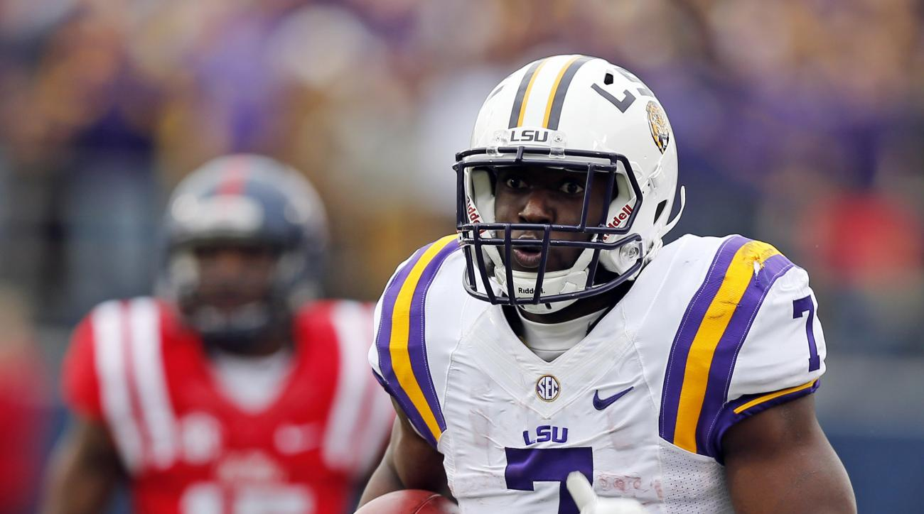 LSU running back Leonard Fournette (7) runs past Mississippi defensive back Kendarius Webster (15) for a long gain in the first half of an NCAA college football game in Oxford, Miss., Saturday, Nov. 21, 2015. (AP Photo/Rogelio V. Solis)