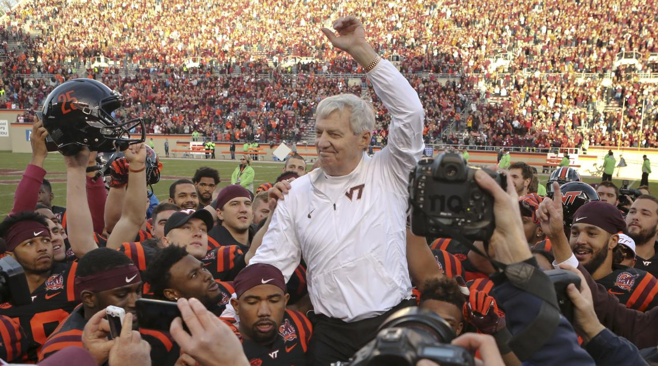 Virginia Tech head coach Frank Beamer is carried off the field by his players after an NCAA college football game in Blacksburg, Va., Saturday, Nov. 21, 2015.  North Carolina won the game 30-27 in overtime, but it was Beamer's last home game as coach sinc