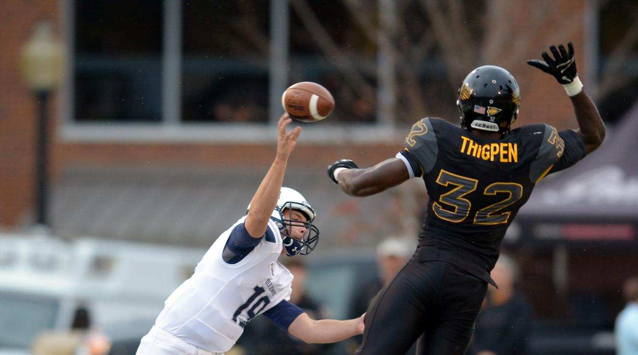 Old Dominion's Shuler Bentley (19) throws a pass as Southern Mississippi's Xavier Thigpen (32) defends during an NCAA college football game Saturday, Nov. 21, 2015, in Hattiesburg, Miss. (Eli Baylis/The American via AP)