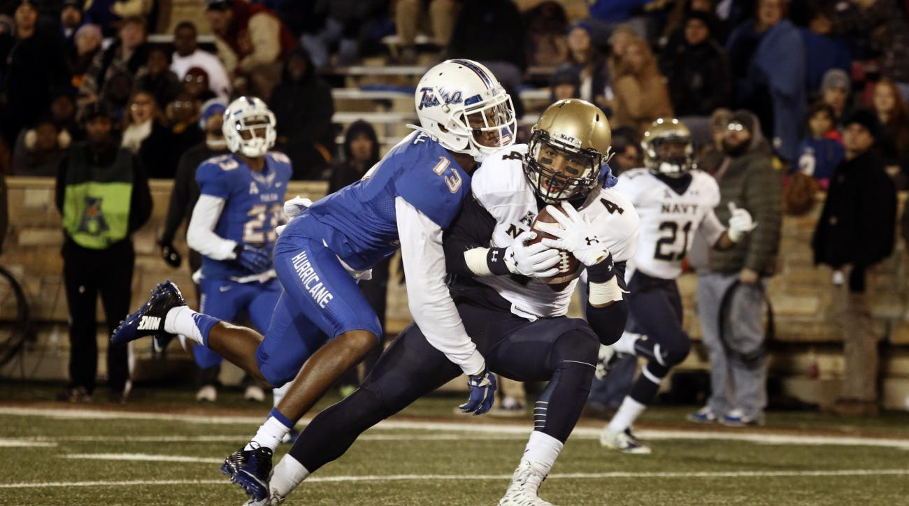 Navy wide receiver Jamir Tillman (4) runs for a touchdown as Tulsa safety Jordan Mitchell (13) defends during the first half of an NCAA college football game in Tulsa, Okla., Saturday, Nov. 21, 2015. (AP Photo/Brett Deering)