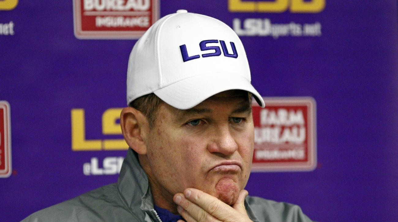 LSU head coach Les Miles ponders a reporter's question's following an NCAA college football game against Mississippi in Oxford, Miss., Saturday, Nov. 21, 2015. Mississippi won 38-17. (AP Photo/Rogelio V. Solis)