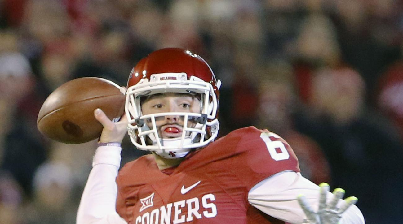 Oklahoma quarterback Baker Mayfield (6) looks to pass against TCU during the first quarter of an NCAA college football game in Norman, Okla., Saturday, Nov. 21, 2015. (AP Photo/Alonzo Adams)