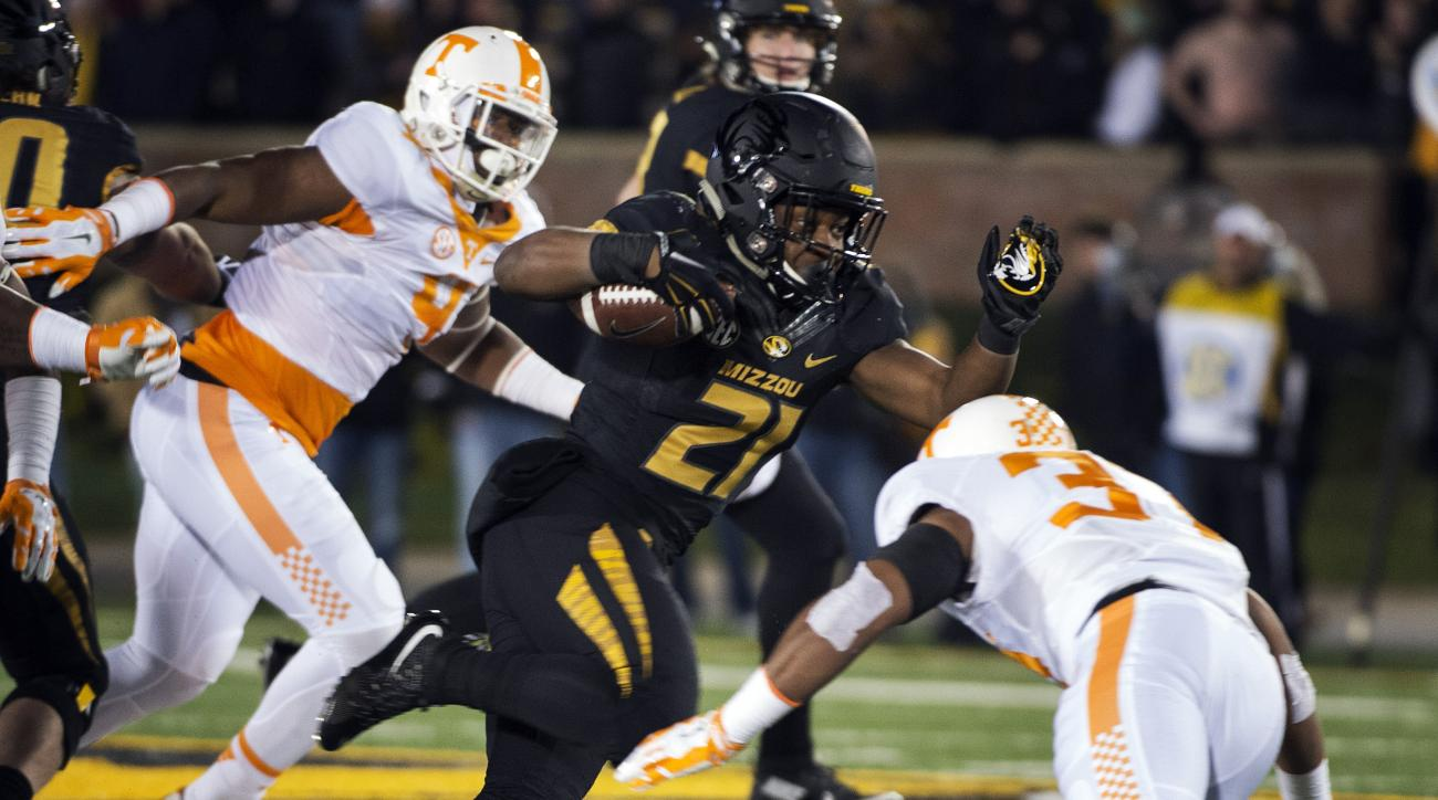 Missouri's Ish Witter, center, is tackled by Tennessee defensive back Brian Randolph, right, during the first half of an NCAA college football game Saturday, Nov. 21, 2015, in Columbia, Mo. (AP Photo/L.G. Patterson)