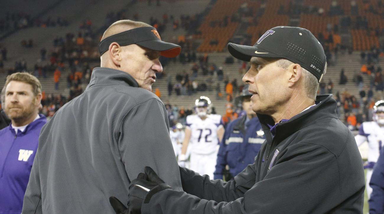 Oregon State coach Gary Andersen, left, and Washington coach Chris Petersen meet after an NCAA college football game in Corvallis, Ore., Saturday, Nov. 21, 2015. Washington won 52-7. (AP Photo/Timothy J. Gonzalez)