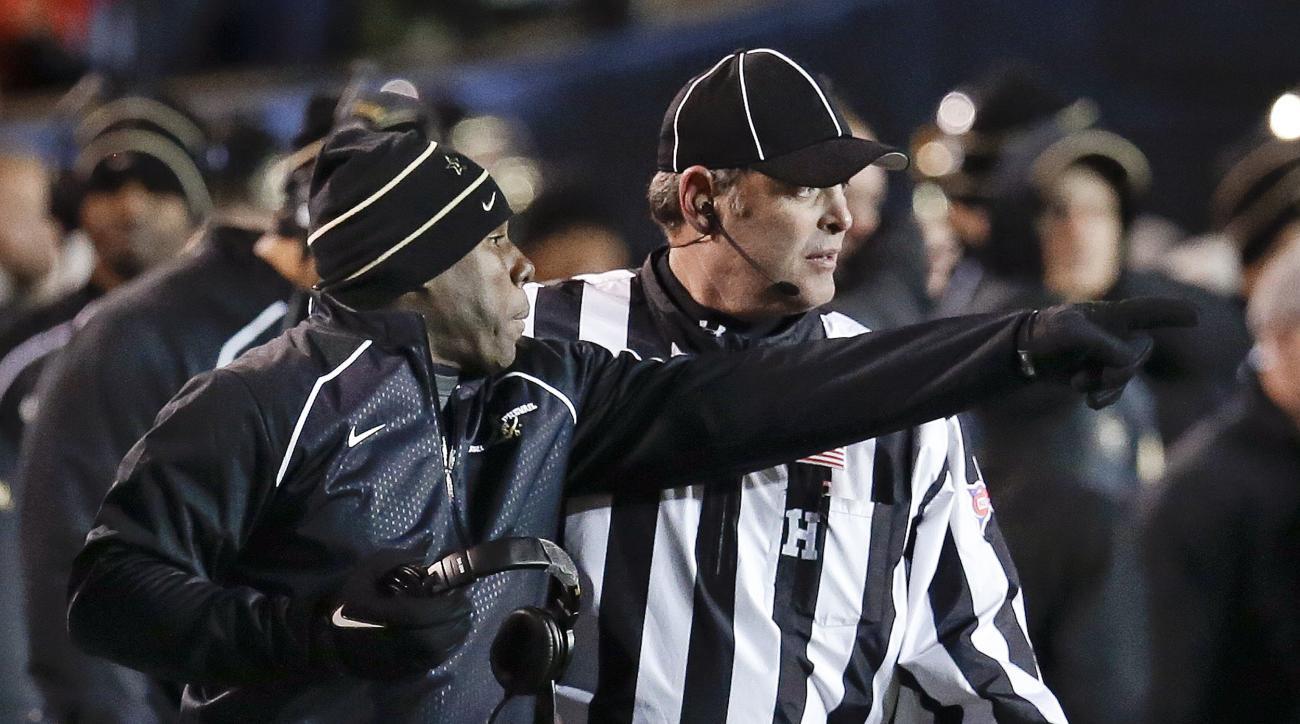 Vanderbilt head coach Derek Mason, left, protests a call in the first half of an NCAA college football game against Texas A&M, Saturday, Nov. 21, 2015, in Nashville, Tenn. (AP Photo/Mark Humphrey)