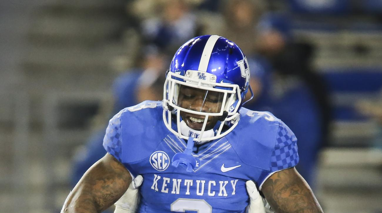 Kentucky running back Jojo Kemp is hoisted in the air by offensive tackle Kyle Meadows while celebrating after Kemp scored a touchdown during the second half of an NCAA college football game against Charlotte, Saturday, Nov. 21, 2015, in Lexington, Ky. Ke