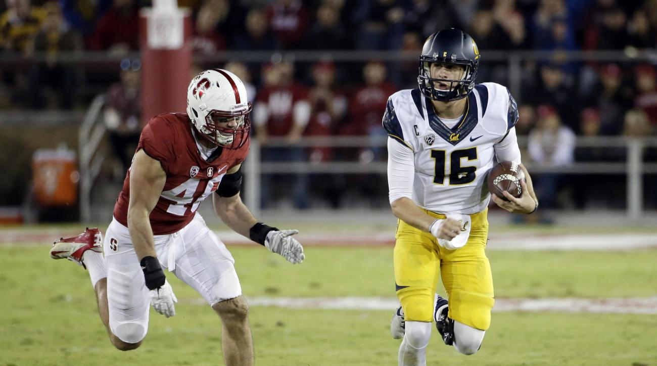 California quarterback Jared Goff (16) runs past Stanford linebacker Kevin Anderson (48) during the first half of an NCAA college football game Saturday, Nov. 21, 2015, in Stanford, Calif. (AP Photo/Marcio Jose Sanchez)