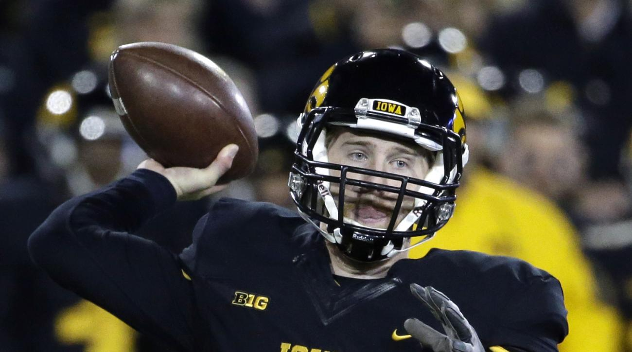 FILE - In this Nov. 14, 2015, file photo, Iowa quarterback C.J. Beathard throws during the first half of an NCAA college football game against Minnesota, in Iowa City, Iowa. Nebraska, which knocked off an unbeaten Michigan State two games ago, gets an opp